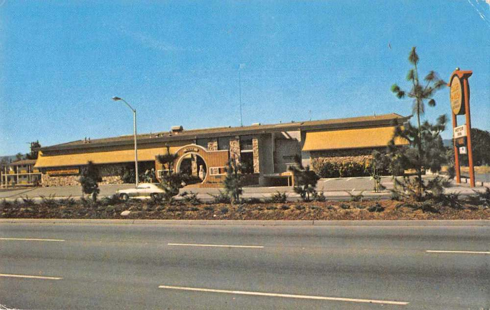 A very retro building in mustard yellow without the usual exotic trappings of an American Chinese restaurant, though notably a big circular gate.