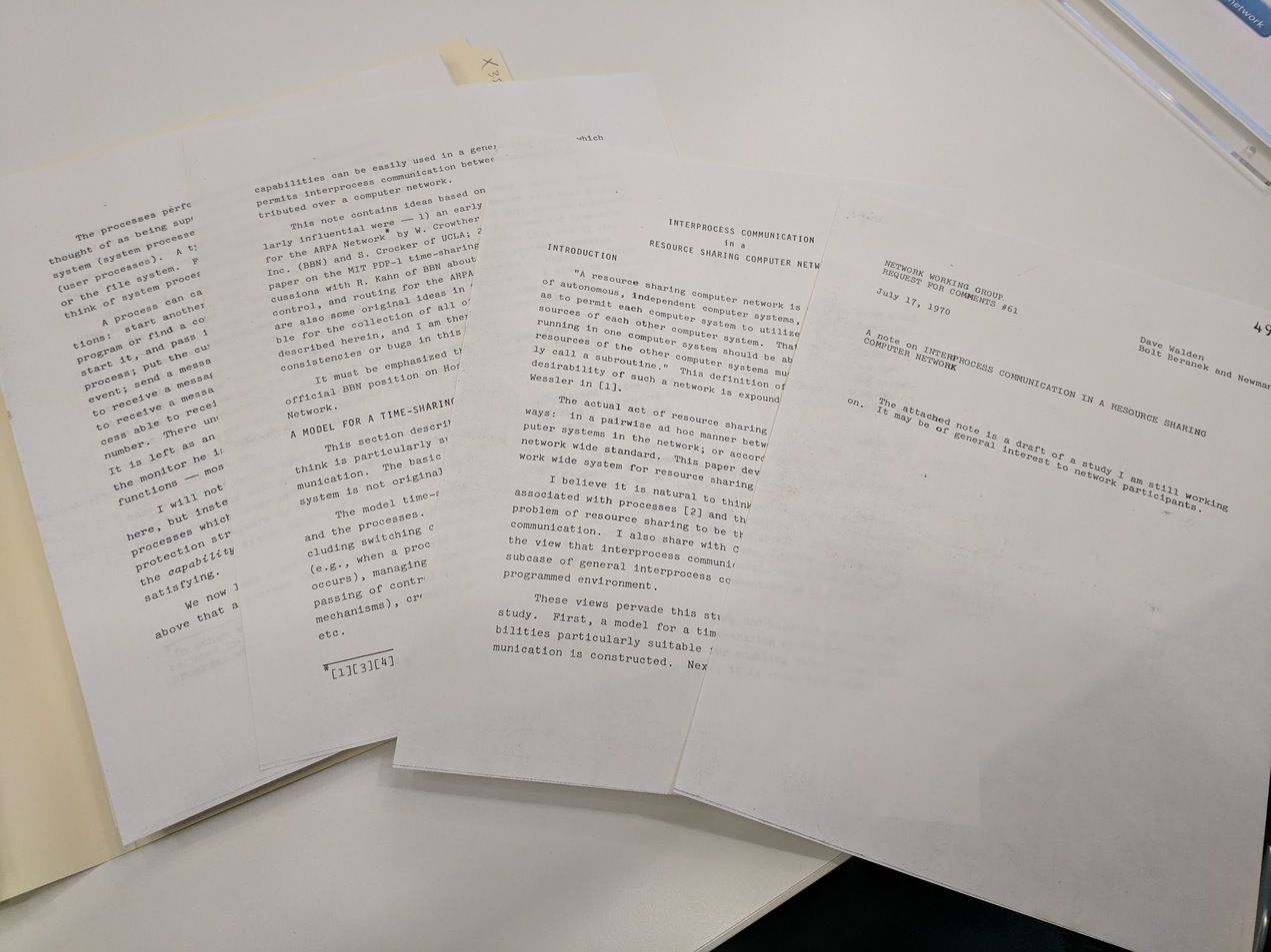 Four handsomely typewritten pages fanned out on a desk.